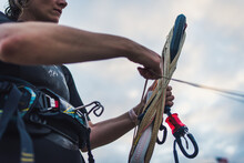 A Woman Wrapping Up Her Kiteboarding Line