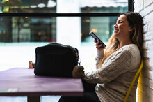Happy Woman Using Voice Recognition On Her Phone