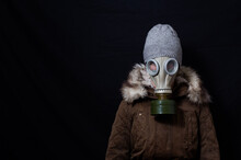 Woman In Coat And Mask Looking Sad