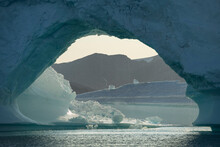 View Through Arch In Large Iceberg, East Greenland