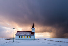 A Red-roof Church On The Coast Of Iceland In The Winter