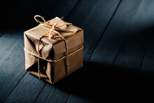 Package Wrapped In Kraft Paper And Tied With String