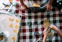 Overhead Of Two Children Preparing Sugar Cookie Dough At Table