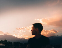 Man Admiring The Sunset With His Face Blurred