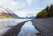 Snowy Mountains In Clouds, Viewed From Shore Of Kenai Lake, Alaska