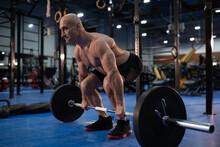 Concentrated Senior Athlete Preparing To Deadlift