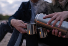 Crop Couple Filling Cups With Tea