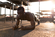 Sportive Serious Black Man Doing Plank