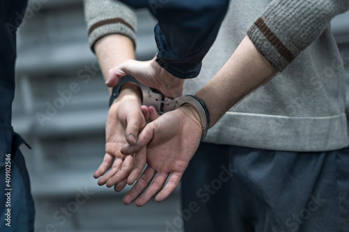 Foto handcuffing the arrested person. Implementation of the arrest
