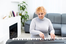 Stylish Adult Woman Playing Synthesizer