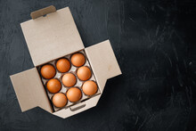 Fresh Eggs On Paper Egg Box, On Black Background, Top View Flat Lay , With Space For Text  Copyspace