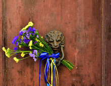 Flower Bouquet Inserted Into A Door Knocker To Mark The Holiday