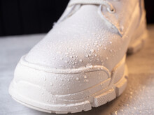 Water Droplets On Winter Shoe Protected With Waterproof Spray