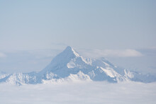 Deep Wintry Mountain Of Dachstein Mountain Above The Fog