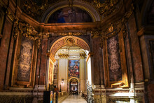 View Looking Through Doorway Of A Small Chapel To The Golden, Ornately Decorated Interior Apse Of The Basilica Of Sant'Andrea Della Valle In Rome, Italy.