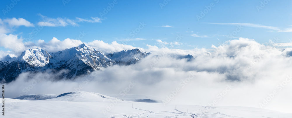 Fototapeta Ski resort landscape on clear sunny day. Panoramic view of mountains near Brianson, Serre Chevalier resort. Mountain ski resort. Snow slope. Snowy mountains. Winter vacation.