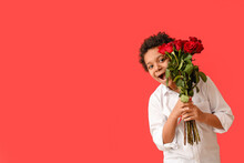 Surprised African-American Boy With Bouquet Of Beautiful Flowers On Color Background