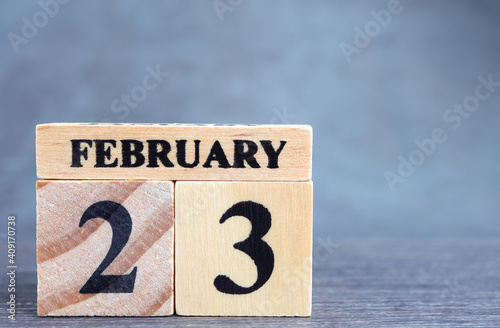 Obraz Day 23 of february month, Wooden calendar with date. Empty space for text. - fototapety do salonu