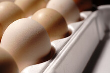 Chicken Eggs In White Special In-store Packaging. Closeup.