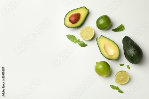 Tablou Canvas Avocado, lime and basil on white background, space for text