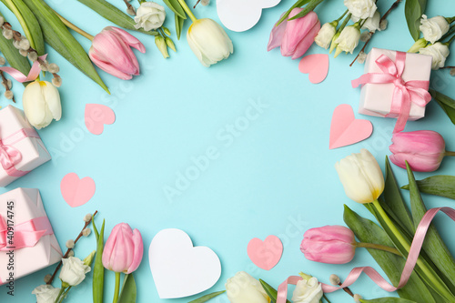 Obraz 8 march concept with different flowers and gift boxes on blue background, space for text - fototapety do salonu