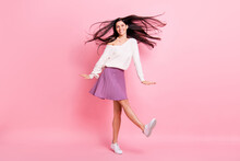Full Size Photo Of Young Attractive Positive Smiling Cheerful Girl With Flying Hair Dancing Isolated On Pink Color Background