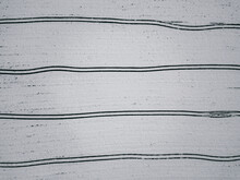 Tractor Tracks On A Snowy Field. Aerial Photography.
