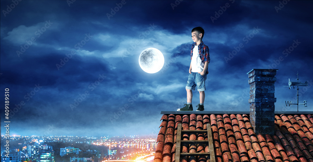 Fototapeta Boy on the roof and the moon.