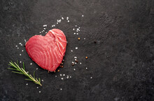 Heart Shaped Raw Tuna Steak With Rosemary And Spices On Stone Background With Copy Space For Your Text