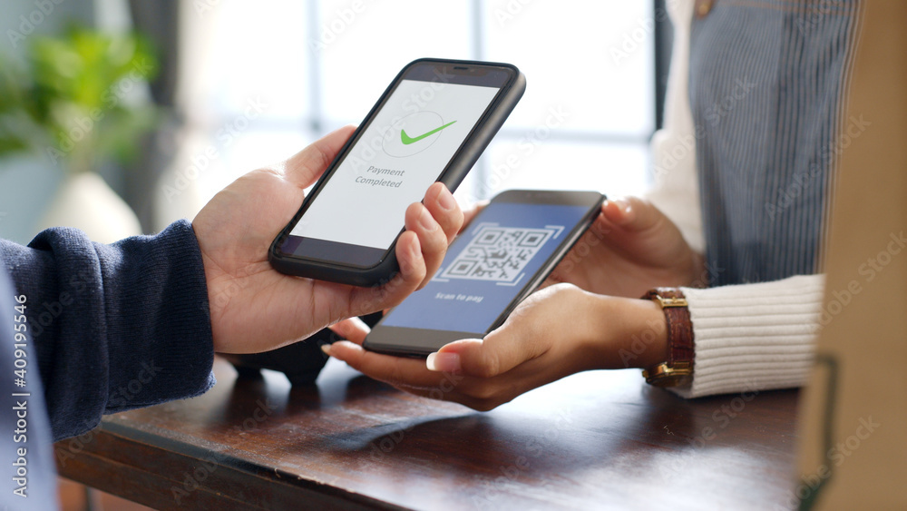 Fototapeta Customer using phone for payment at cafe restaurant, cashless QR code technology and money transfer concept