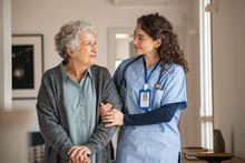 Caregiver Assist Senior Woman At Home