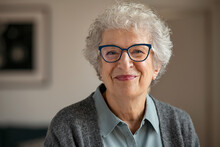 Senior Smiling Woman With Spectacles Looking At Camera
