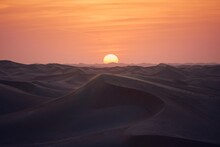 Sand Dunes In Desert Landscape At Beautiful Sunset. Abu Dhabi, United Arab Emirates