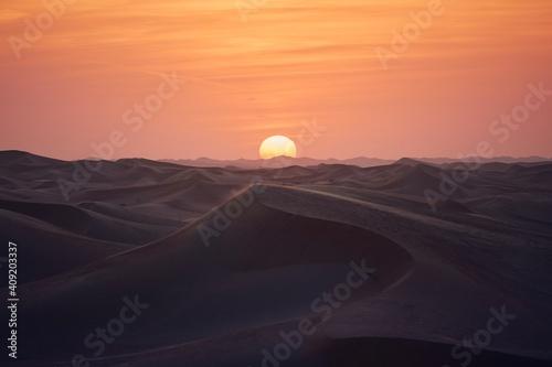 Tela Sand dunes in desert landscape at beautiful sunset