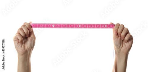 Obraz Woman holding pink measuring tape on white background, closeup - fototapety do salonu