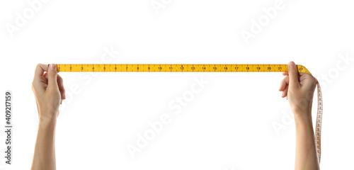 Obraz Woman holding yellow measuring tape on white background, closeup - fototapety do salonu