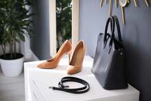 Stylish Women's Shoes, Belt And Bag In Modern Boutique