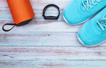 Watch, Music And Blue Sports Shoes On A Rustic Background, Top View. Healthy Lifestyle Concept