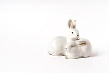 Ceramic White Hares, Vintage Figurine On A White Background