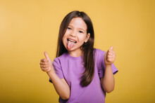 The Cheerful Girl Makes Faces And Shows Her Tongue. Leisure Of The Child.