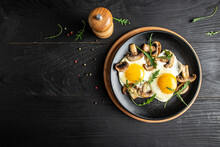 Keto, Paleo Breakfast Fried Eggs With And Mushrooms. Menu Recipe Place For Text, Top View