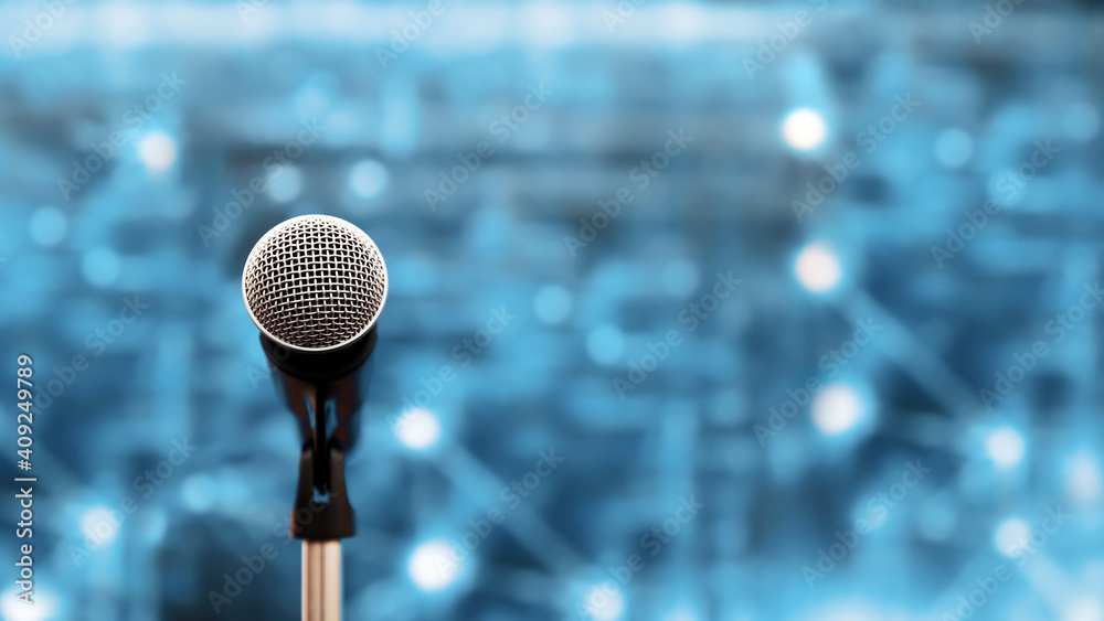Fototapeta Public speaking backgrounds, Close-up the microphone on stand for speaker speech presentation stage performance with technology blur bokeh light background.