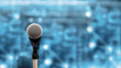Leinwandbild Motiv Public speaking backgrounds, Close-up the microphone on stand for speaker speech presentation stage performance with technology blur bokeh light background.