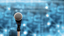 Public Speaking Backgrounds, Close-up The Microphone On Stand For Speaker Speech Presentation Stage Performance With Technology Blur Bokeh Light Background.
