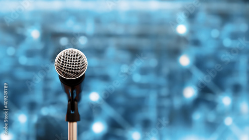 Public speaking backgrounds, Close-up the microphone on stand for speaker speech presentation stage performance with technology blur bokeh light background Fototapet
