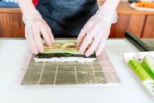 Expert Japanese Chef Preparing Sushi Roll