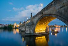 Illuminated Charles Bridge With Reflections At Night, Prague, Bohemia, Czech Republic