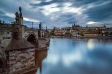 Prague Castle And Charles Bridge On Vltava River In City, Prague, Bohemia, Czech Republic