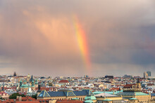 Rainbow Over Prague Skyline Against Cloudy Sky During Sunset, Czech Republic