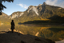 An Anonymous Person Looking Across A Reflective Lake In Germany